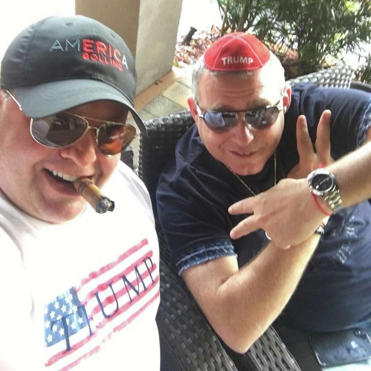 Robert Hyde (left), a Republican candidate for Congress in Connecticut's 5th District, smokes a cigar with Lev Parnas (right), Soviet-born businessman and associate of Rudy Giuliani indicted on campaign finance violations.