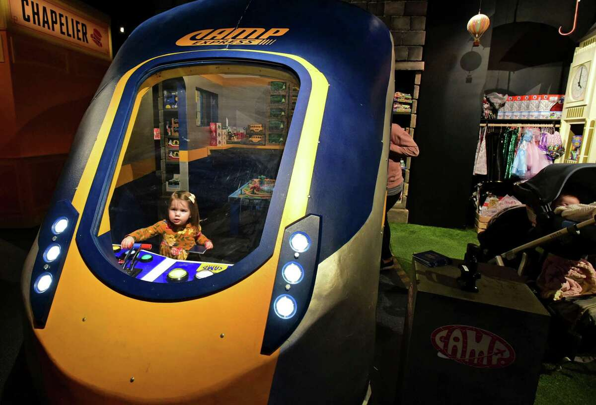 Children enjoy the CAMP Express as the Camp toy store opens Thursday, November 21, 2019, at The SoNo Collection mall in Norwalk, Conn. One of the Connecticut newcomers to the mall with the NYC entity offering experiential learning activities and related products for families. Located Level 3 of the mall at the northwest corner.