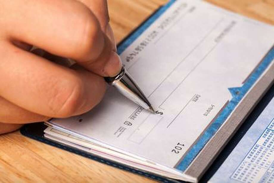 Pearland officers recently documented numerous reports of checks being forged or stolen, according to a department release. Photo: Fotolia / Fotolia / BillionPhotos.com - Fotolia