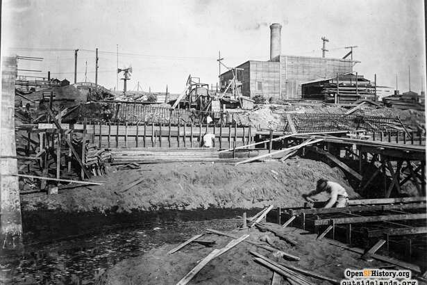 In the background of this 1916 photo of the Ocean Beach Esplanade's construction, you can see the smoke stack for the Lurline Baths salt water pumphouse. (Photo: Western Neighborhoods Project - wnp36.01315)