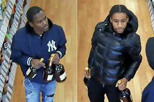 Newtown police are searching for two men suspected of fraudulently using credit and debit cards at local liquor stores.
