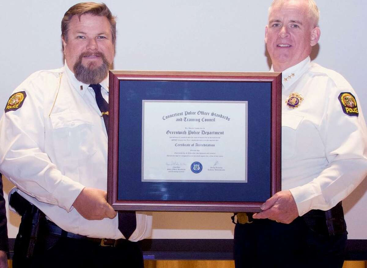 Lt. David Nemecek and Police Chief James Heavey display the certificate of compliance for the Connecticut Law Enforcement Accreditation Program.