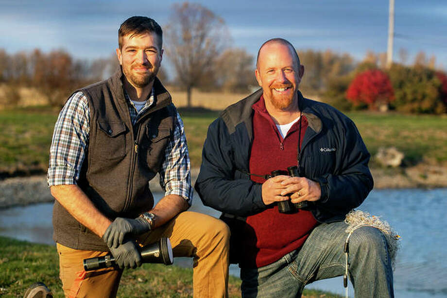 Grad student Ryan Askren, left, and orinthologist Michael Ward, both from the University of Illinois at Urbana-Champaign, Department of Natural Resources and Environmental Sciences and Illinois Natural History Survey, have used tracking devices on Canada geese to plot how their patterns of movement affect airport safety.