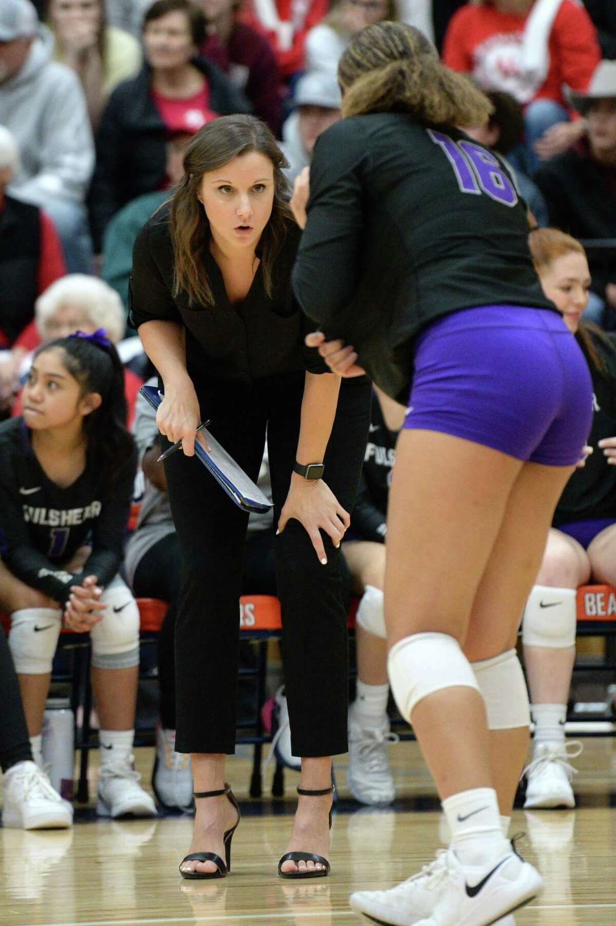 Head Coach Sydney Gotcher of Fulshear talks to a player during the first set of a Class 4A Region IV Quarterfinal volleyball playoff match between the Fulshear Chargers and the Bellville Brahamanettes on Tuesday, November 12, 2019 at Bridgeland HS, Cypress, TX.