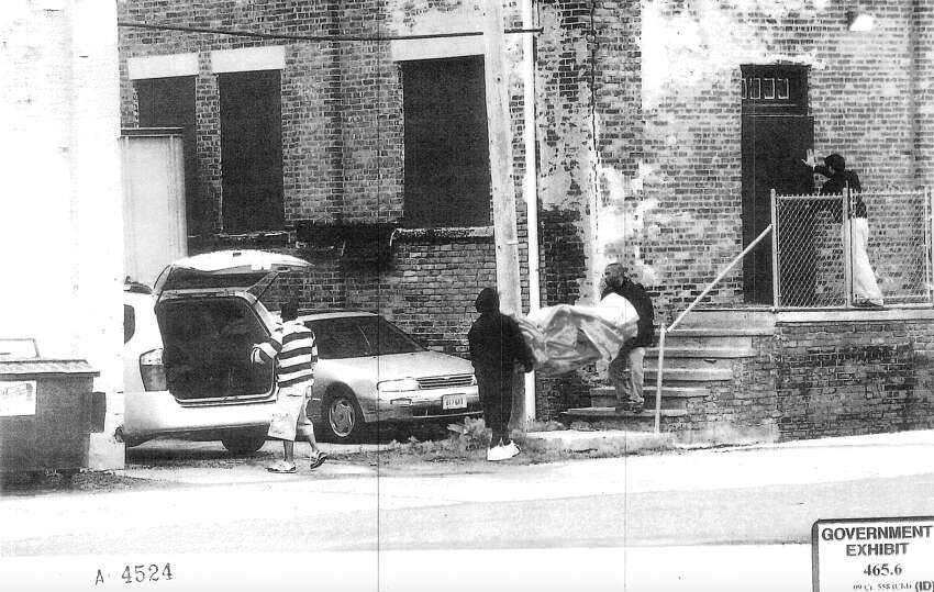 This photograph featuring FBI informant Shahed Hussain, closing door at right, were used as evidence by federal prosecutors at the 2010 trial of the so-called Newburgh Four in 2010 White Plains. During 2008 and 2009, Hussain posed as a wealthy businessman to enlist four Newburgh residents in a fake plot to bomb Bronx synagogues.