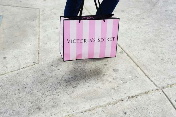 A shopper carries a Victoria's Secret retail bag in New York on March 30, 2019.