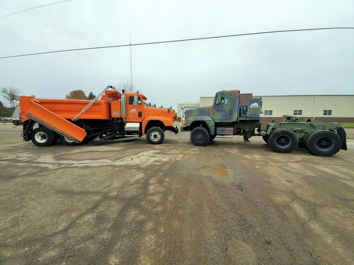 Nose to nose, on therightone of the trucks still sports its original drab camo paint and on theleft is a seemingly brand new truck, each with the same origin.(Scott Nunn/Huron Daily Tribune)