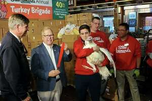 Danbury Mayor Mark Boughton pardoned Dot the turkey during Stew Leondard's 40th annual Turkey Brigade, where the grocery store donated nearly 1,800 turkeys ahead of Thanksgiving.