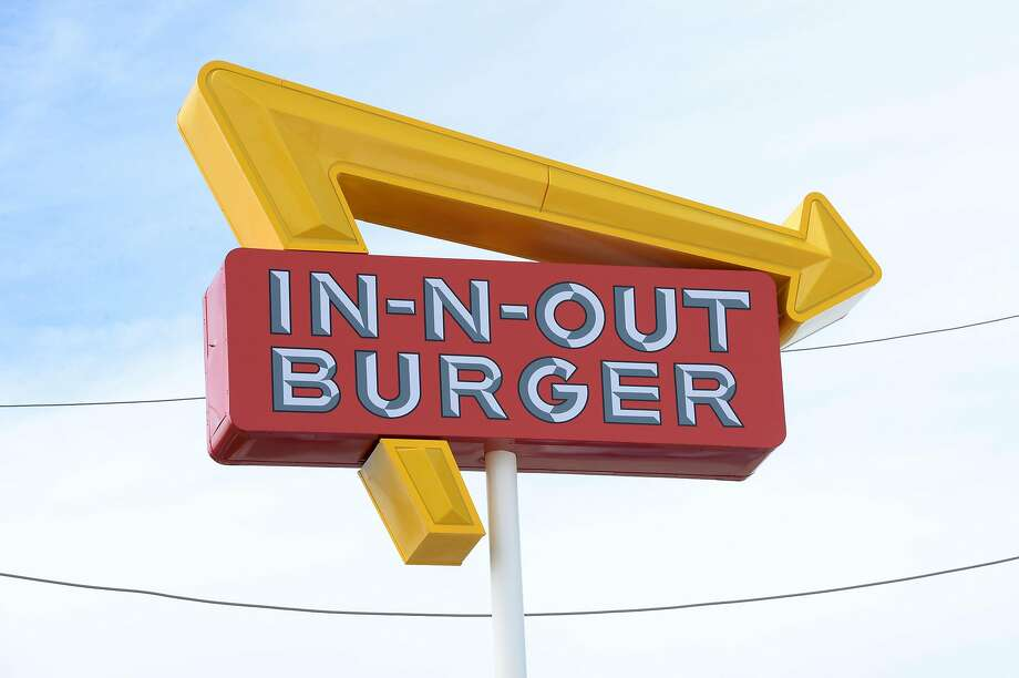 FILE - The In-N-Out Burger sign in Katy, TX. In-N-Out is suing its insurer, Zurich American Insurance, over being denied its COVID-19 claims. Photo: Craig Moseley, Staff Photographer
