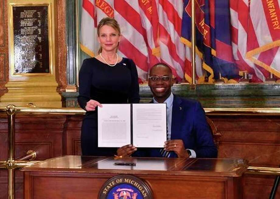 State Rep. Michele Hoitenga is joined by Lt. Gov. Garlin Gilchrist for a bill-signing ceremony Thursday at the Capitol in Lansing. (Courtesy photo)