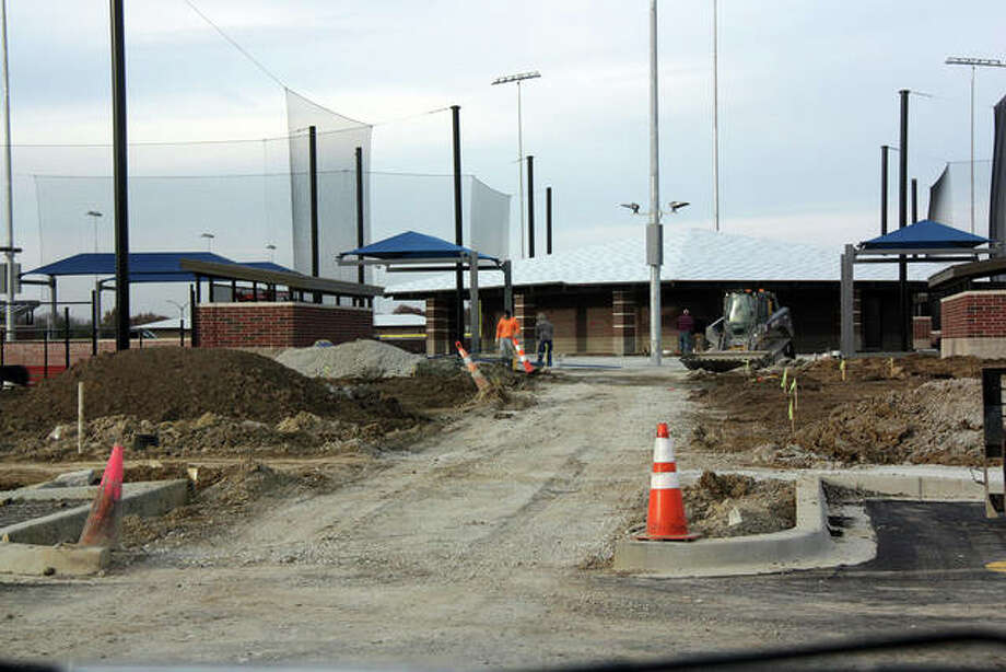 The future path between two of the four junior baseball/softball diamonds at Plummer Family Sports Park. In the distance is the restroom/concession stand that will serve all four diamonds. Note the blue shade structures are in place and at least two of the dugouts are near completion. Photo: Charles Bolinger|The Intelligencer