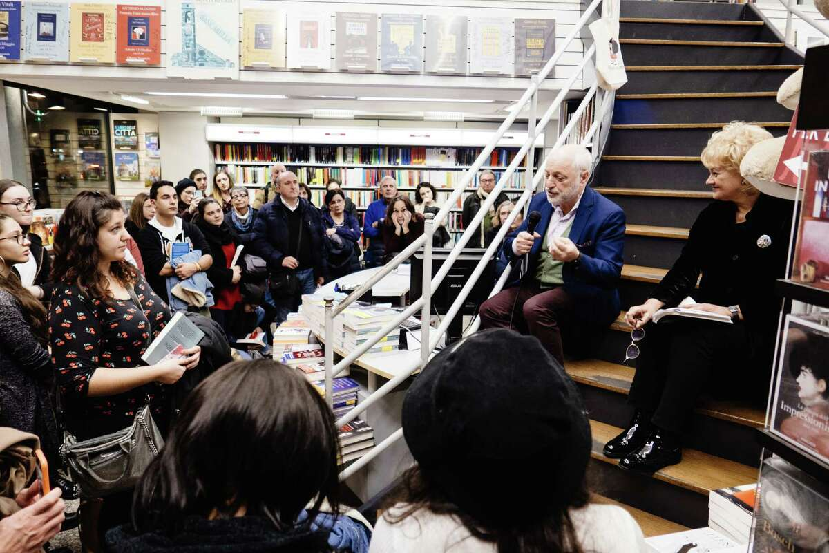 American writer Andre Aciman and Laura Bosio attend the presentation of his new book