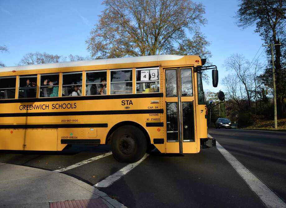 Buses depart during dismissal at Central Middle School in Greenwich, Conn. Thursday, Nov. 21, 2019. Photo: File / Tyler Sizemore / Hearst Connecticut Media / Greenwich Time