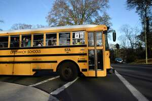 Buses depart during dismissal at Central Middle School in Greenwich, Conn. Thursday, Nov. 21, 2019.