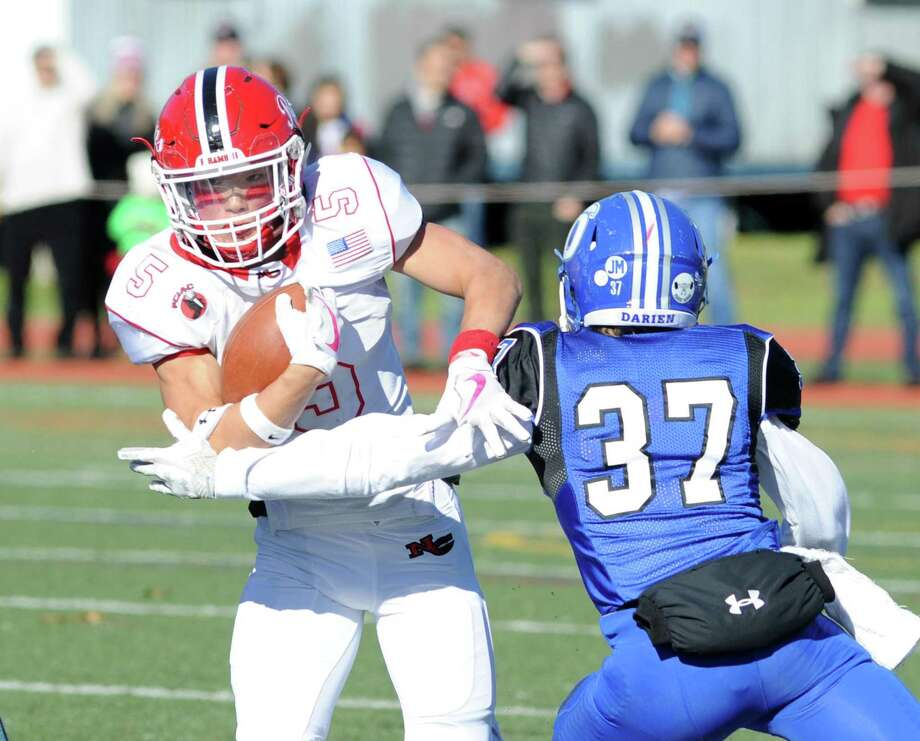 The New Canaan and Darien football teams clash in the 2017 Turkey Bowl game. Photo: Bob Luckey Jr. / Hearst Connecticut Media / Greenwich Time