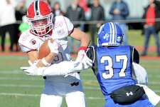 The New Canaan and Darien football teams clash in the 2017 Turkey Bowl game.