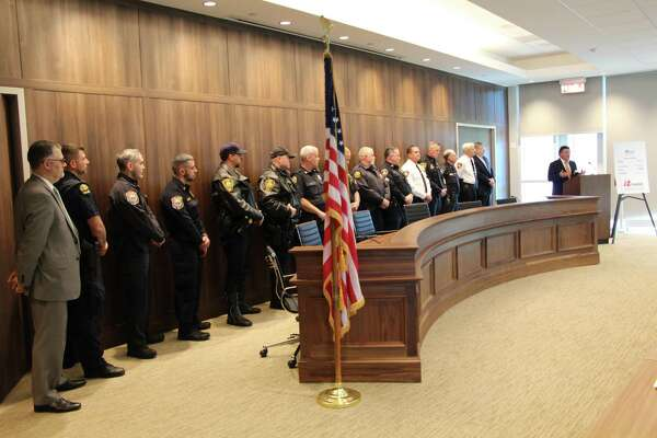 Stamford State's Attorney Richard Colangelo along with officers from Stamford, Darien, Greenwich, Norwalk, Westport and New Canaan who attended a MADD press conference Thursday at the Stamford Police Department on efforts to curb drunk driving over the holidays.