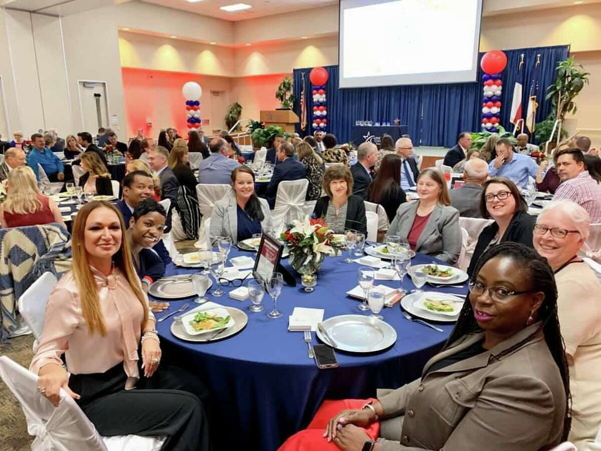 Guests sitting at the Harris County Public Library table pause for a photo during the inaugural Stars of Tomball event at Lone Star College-Tomball on Tuesday, Nov. 19.