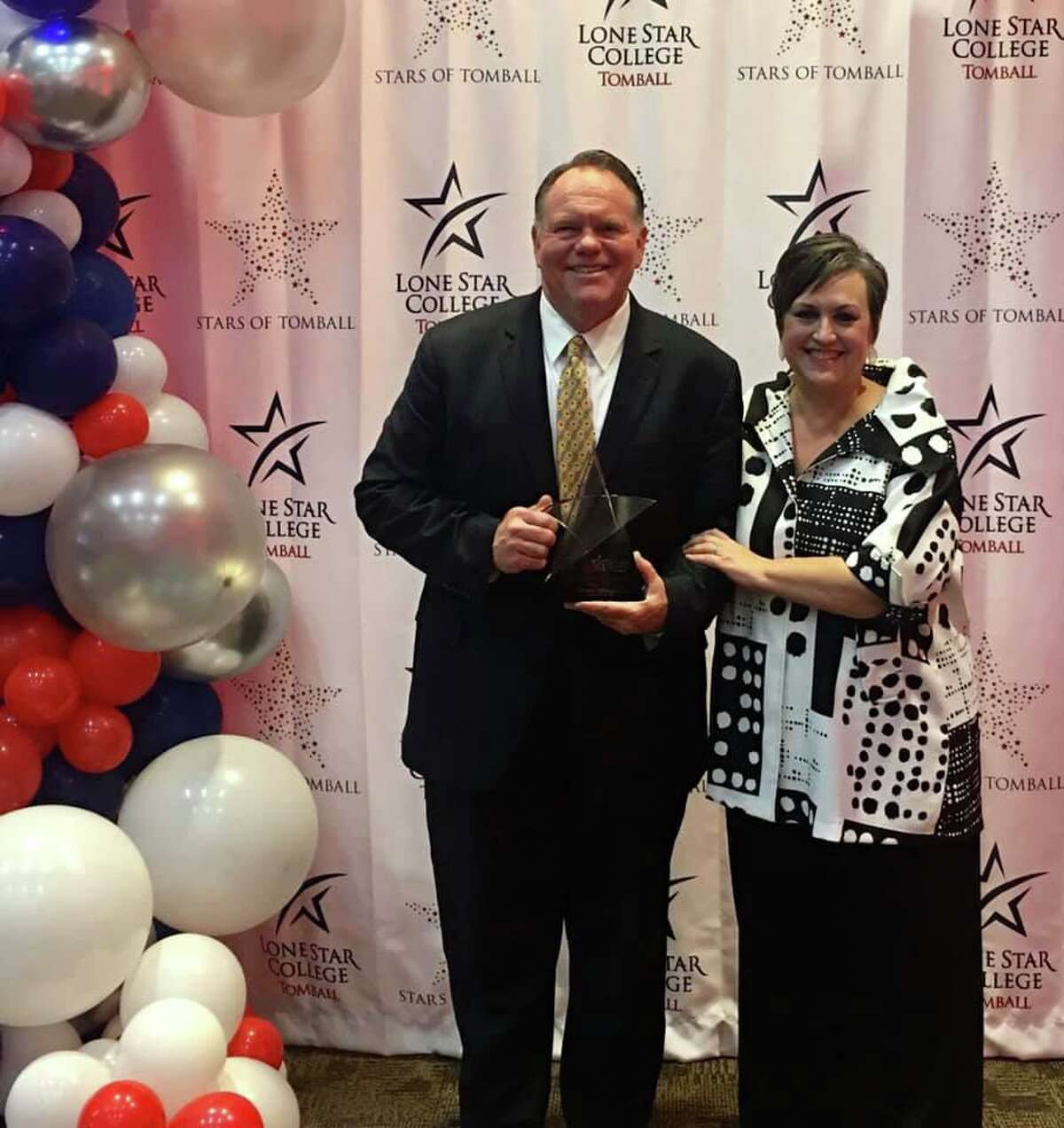 Bruce Hillegeist, president of the Greater Tomball Area Chamber of Commerce, holds the Star of Tomball award while standing with Lee Ann Nutt, president of Lone Star College-Tomball, during the inaugural Stars of Tomball event on Tuesday, Nov. 19, 2019.