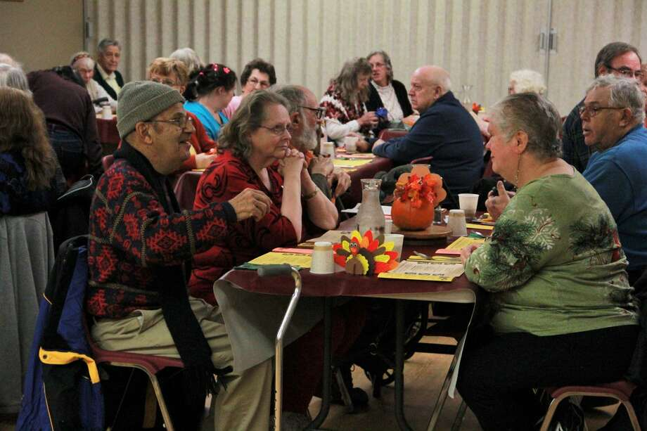 Area residents gathered to celebrate the holidays early during the annual Thanksgiving feast hosted by the Mecosta County Commission on Aging and Activity Center. During the celebration, guests enjoyed a meal with family and friends while singing along to music performed by pianist Dave Marasus. Photo: (Pioneer Photo/Alicia Jaimes)