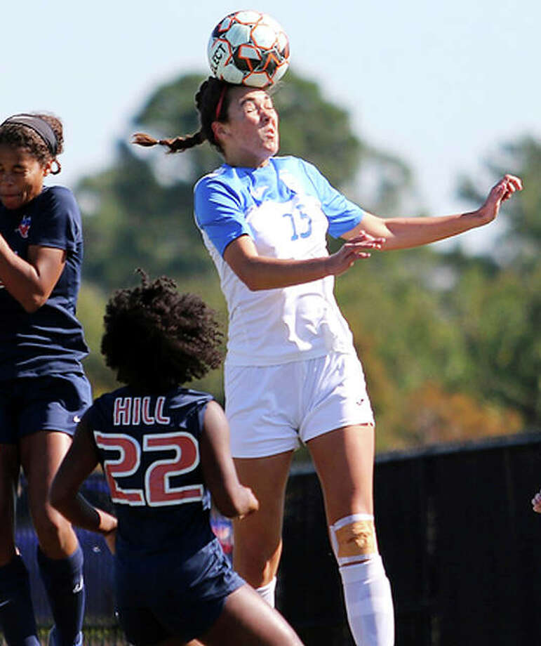 Carlie Smith of Lewis and Clark (15) goes high to head the ball during Wednesday's game against Hill College at the NJCAA Women's National Soccer Tournament in Melbourne, Fla. Photo: NJCAA