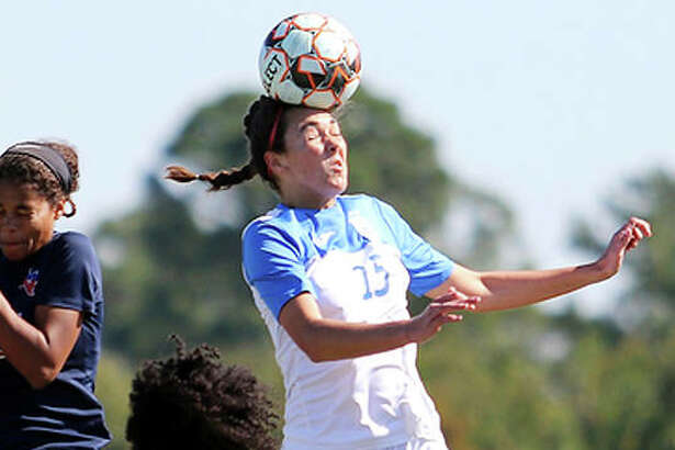 Carlie Smith of Lewis and Clark (15) goes high to head the ball during Wednesday's game against Hill College at the NJCAA Women's National Soccer Tournament in Melbourne, Fla.