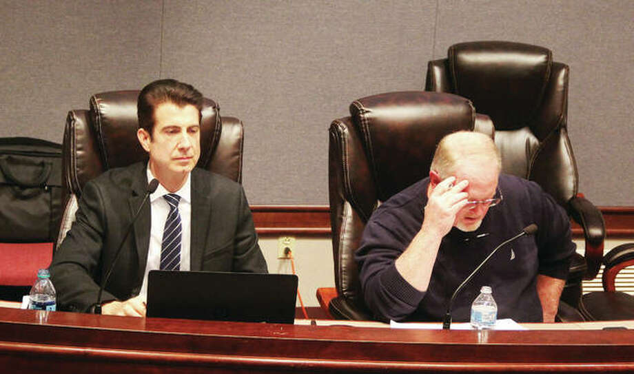 Chris Doucleff, left, was named administrator of Madison County Planning & Development at Wednesday's County Board meeting. He is sitting next to Planning & Development Committee Chairman Mick Madison, R-Bethalto, at last week's meeting.