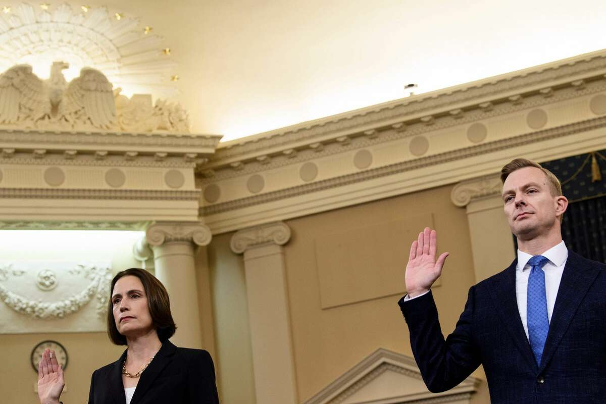 Fiona Hill, the former top Russia expert on the National Security Council, and David Holmes(C), a State Department official stationed at the US Embassy in Ukraine are sworn-in before they testify during the House Intelligence Committee hearing as part of the impeachment inquiry into US President Donald Trump on Capitol Hill in Washington,DC on November 21, 2019. (Photo by Brendan Smialowski / AFP) (Photo by BRENDAN SMIALOWSKI/AFP via Getty Images)