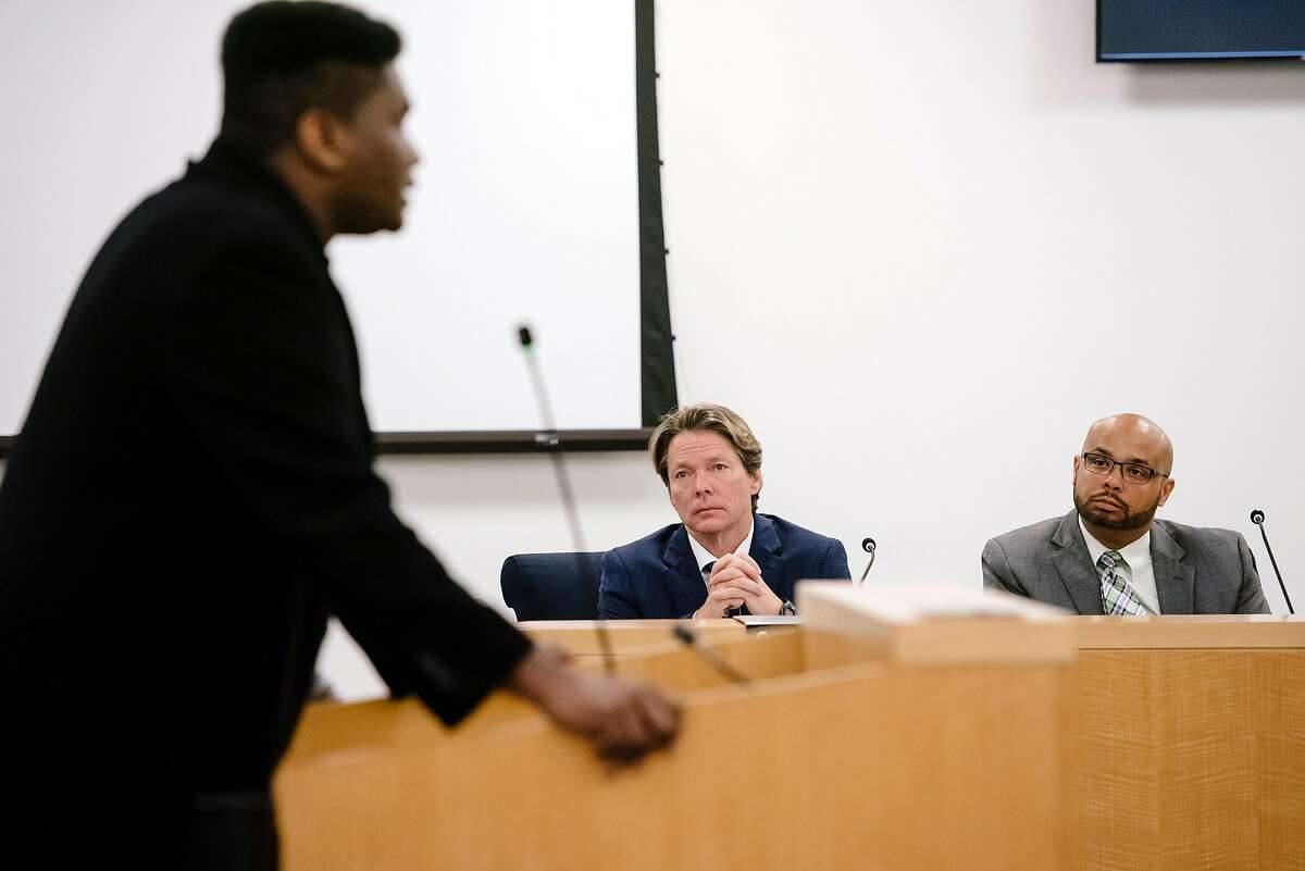 BART general manager Bob Powers (center) and deputy general manager Michael Jones listen to Darrell Owens of East Bay for Everyone during public comments at a BART meeting after the attack.