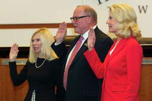 Ann Snyder, Bob Milner and Shelley Sekula-Gibbs are sworn in during a meeting of The Woodlands Township, Wednesday, Nov. 20, 2019, in The Woodlands.