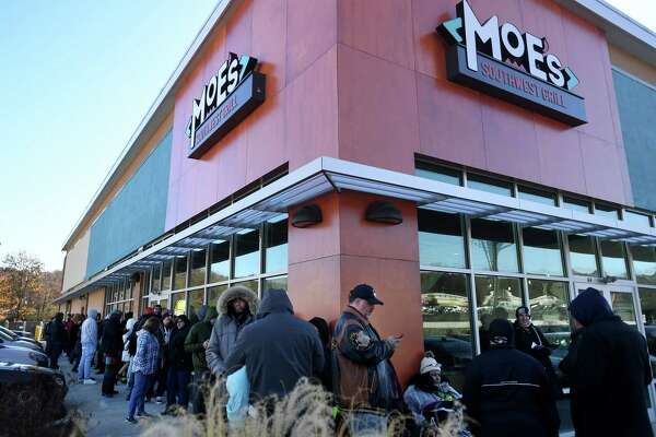 With the promise of free burritos for a year to the first 50 customers, a line began forming at 4:30 a.m. outside the new Moe's Southwest Grill at 44 Pershing Drive in Derby Thursday for the restaurant's grand opening.