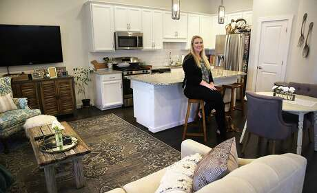 Sarah Redkey in her new three-bedroom, two-and-a-half bathroom home.