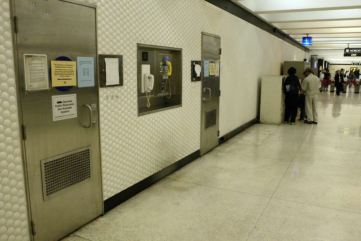 Event on 6/26/04 in San Francisco. the closed BART bathrooms at the Powell street station in SF,and the signs on the doors.