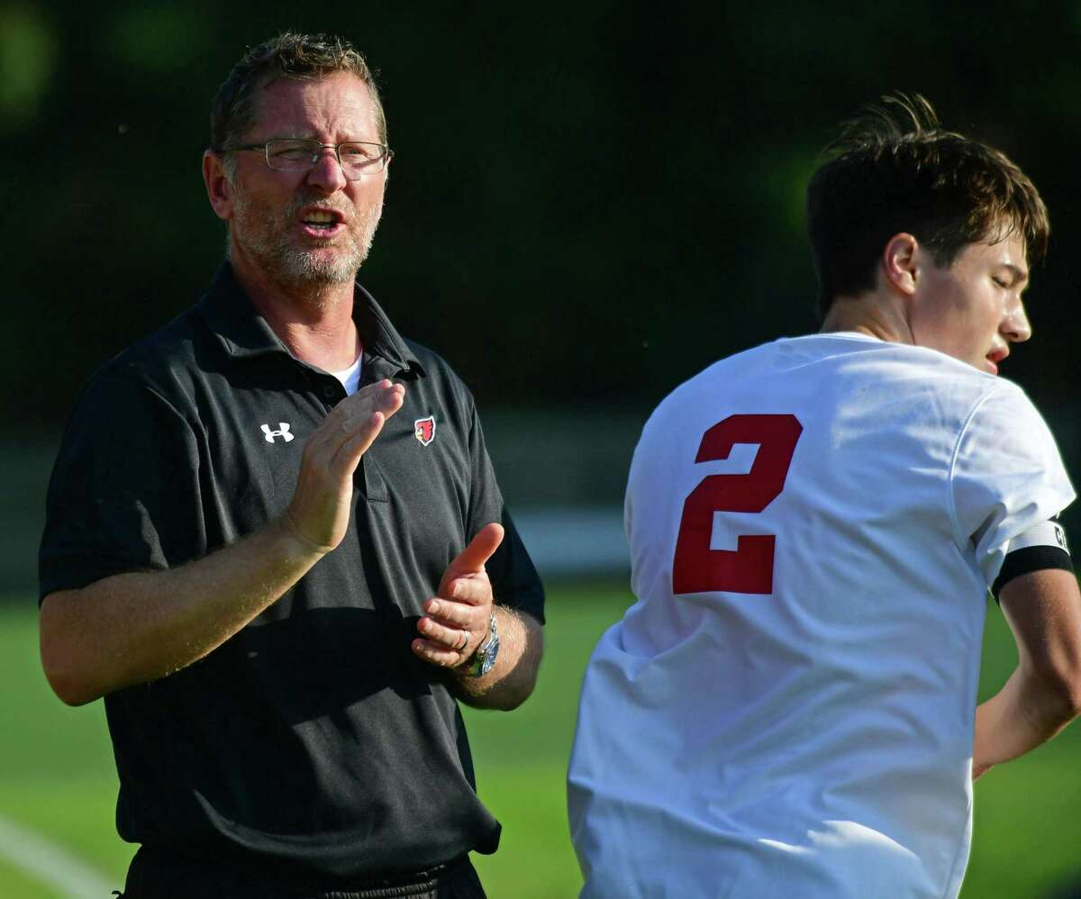 Greenwich coach Kurt Putnam gives instructions against Staples on Oct. 1.