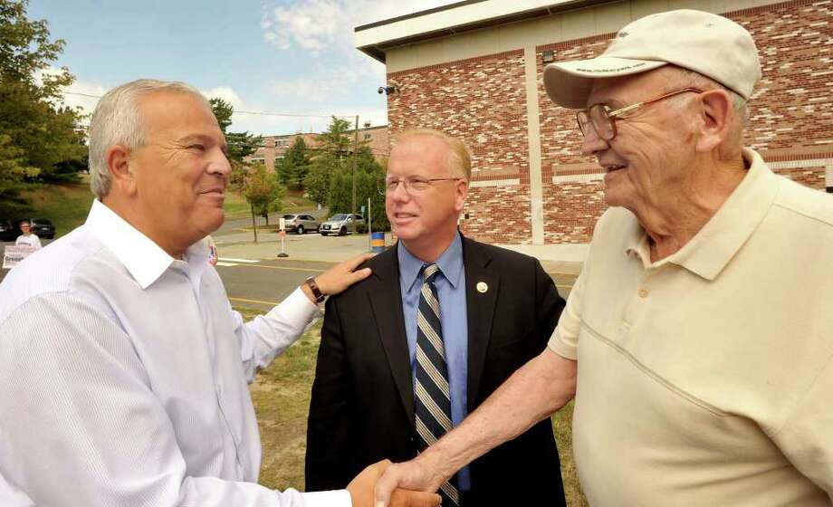 GOP governor candidate Michael Fedele, left, and Danbury Mayor Mark Boughton, who is Fedele's running mate for lieutenant governor, greet Ed Fusek, 86, on his way to vote at Danbury High School, Tuesday, Aug. 10, 2010. Photo: Michael Duffy / The News-Times