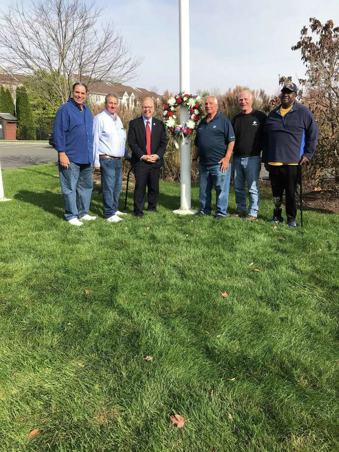 Timber Oaks condos held a ceremony to honor Veterans Day on Nov. 11. From left to right : Charlie Constantino, Pat Brea, Mayor Mark Boughton, Drew Ninos, Frank Cassaniti, Tim Brown. Photo: Contributed Photo / Contributed / The News-Times Contributed