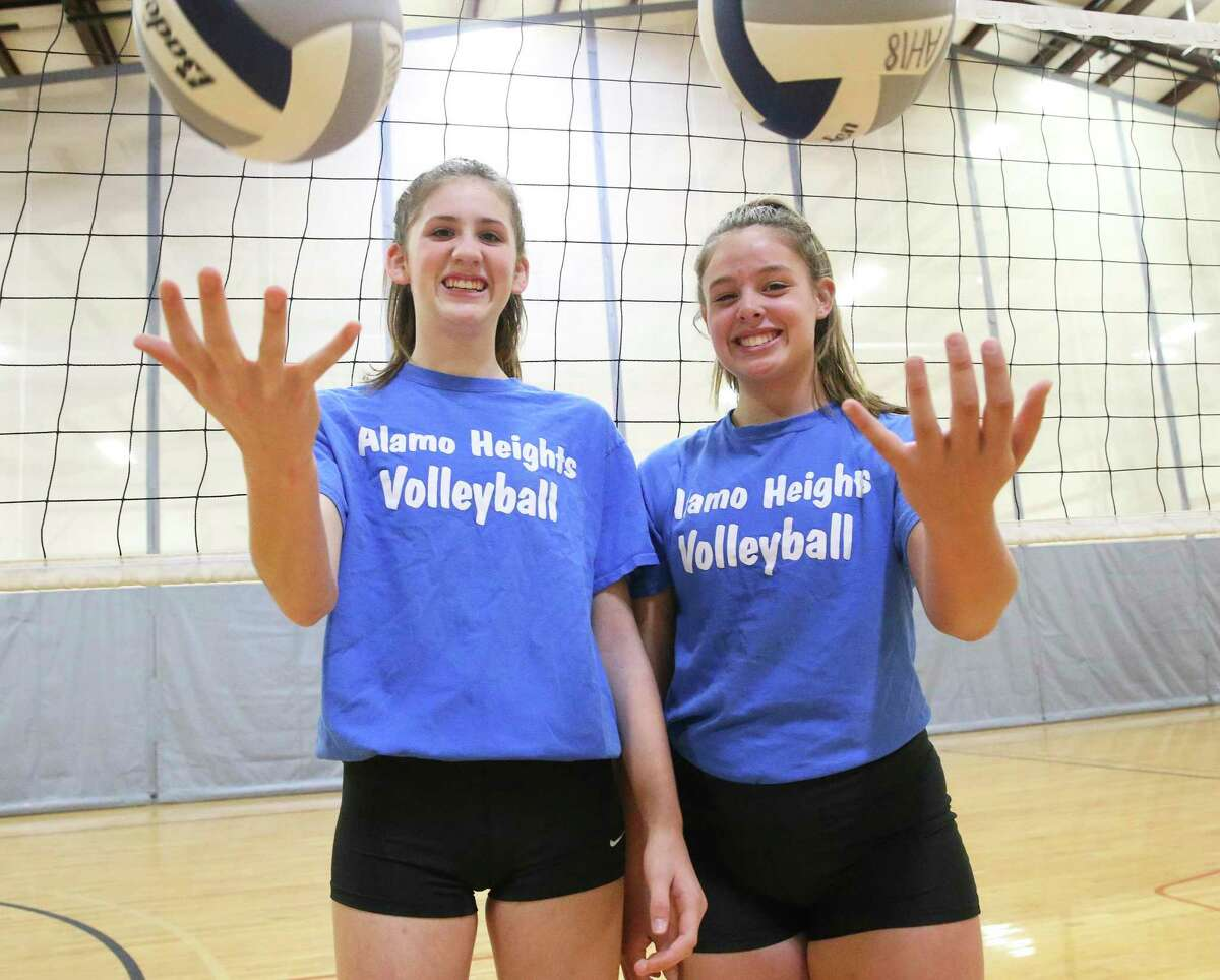 Freshman Hannah Whittingstall, left, and sophomore Kylie Wickley as Alamo Heights volleyball players prepare for the state tournament on Nov.19, 2019.