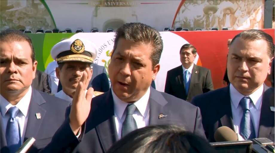 Tamaulipas Gov. Francisco Javier García Cabeza de Vaca spoke to the media about the recent increase in violence in the Sister City. He attended the Mexican revolution parade on Wednesday in Nuevo Laredo. Photo: Courtesy