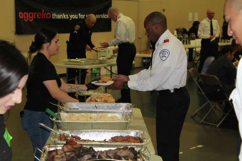 Houston Police Department Cadets and officers receive and eat meals at the 7th annual Banquet for Badges Thursday, Nov. 21. Photo: Paul Wedding