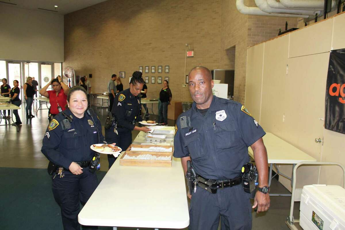 Houston Police Department Cadets and officers receive and eat meals at the 7th annual Banquet for Badges Thursday, Nov. 21. The event was held by Aggreko North America as a way to say thank you to Houston police officers.