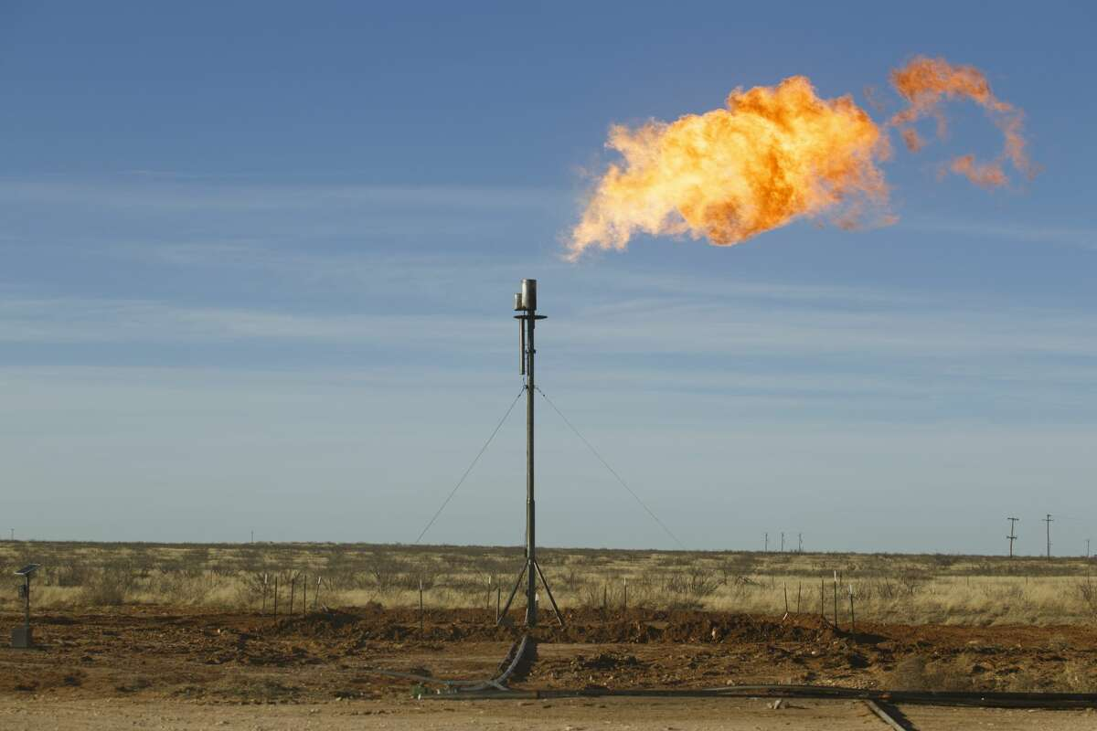 FILE-- A flare is shown at a well site north of Odessa. A recent daylong discussion on reducing flaring and emissions was held recently in Midland. Participants say progress has been made, but there's room for more. (Michael Stravato/The New York Times)