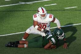 The Woodlands Highlanders defensive lineman Caleb Fox (90) was named to the TSWA All-State first team.