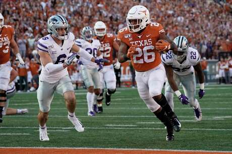 Texas' Keaontay Ingram (26) runs past Kansas State's Johnathan Durham (6) for a touchdown during the second half of an NCAA college football game in Austin, Texas, Saturday, Nov. 9, 2019.