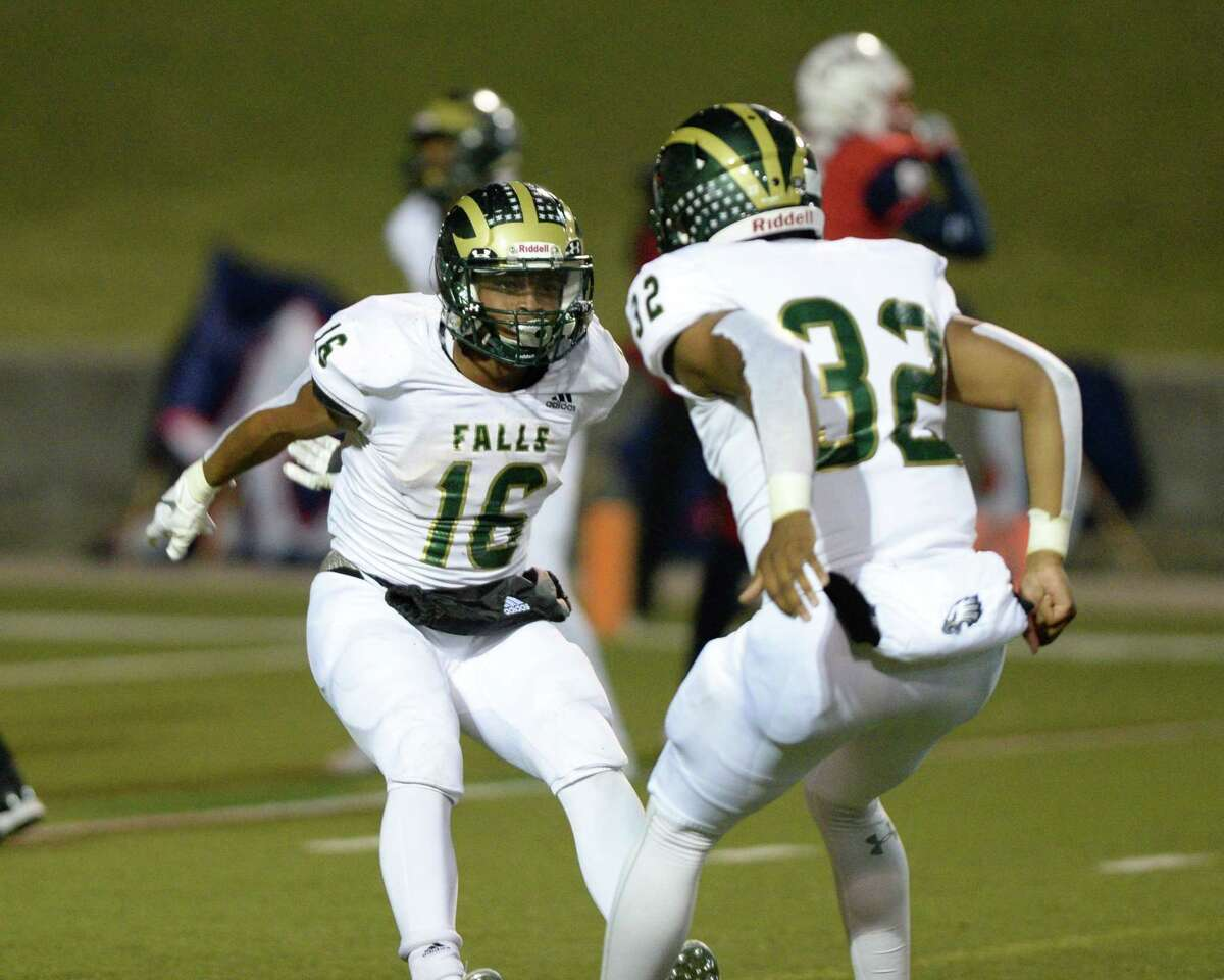 Winston Smith (16) and Isaiah Reyes (32) of Lamar celebrates a touchdown in the final minutes of a Class 6A Division I Region III bi-district football playoff game between the Lamar Texans and the Cy Falls Eagles on Friday, November 15, 2019 at Delmar Stadium, Houston, TX.