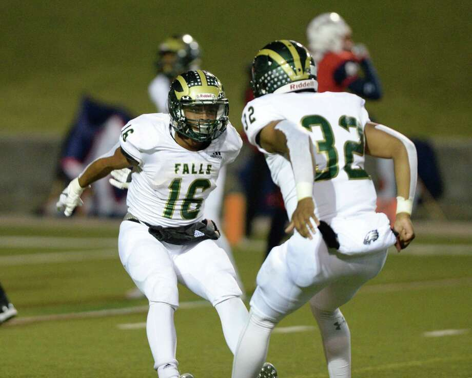 Winston Smith (16) and Isaiah Reyes (32) of Lamar celebrates a touchdown in the final minutes of a Class 6A Division I Region III bi-district football playoff game between the Lamar Texans and the Cy Falls Eagles on Friday, November 15, 2019 at Delmar Stadium, Houston, TX. Photo: Craig Moseley, Houston Chronicle / Staff Photographer / ©2019 Houston Chronicle