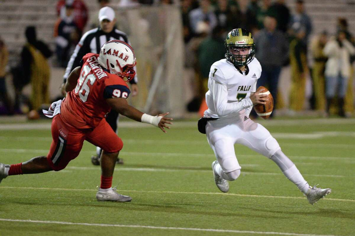 Brandon Collins (7) of Cy Falls is pressured by Josh Stanton (96) of Lamar during the first quarter of a Class 6A Division I Region III bi-district football playoff game between the Lamar Texans and the Cy Falls Eagles on Friday, November 15, 2019 at Delmar Stadium, Houston, TX.
