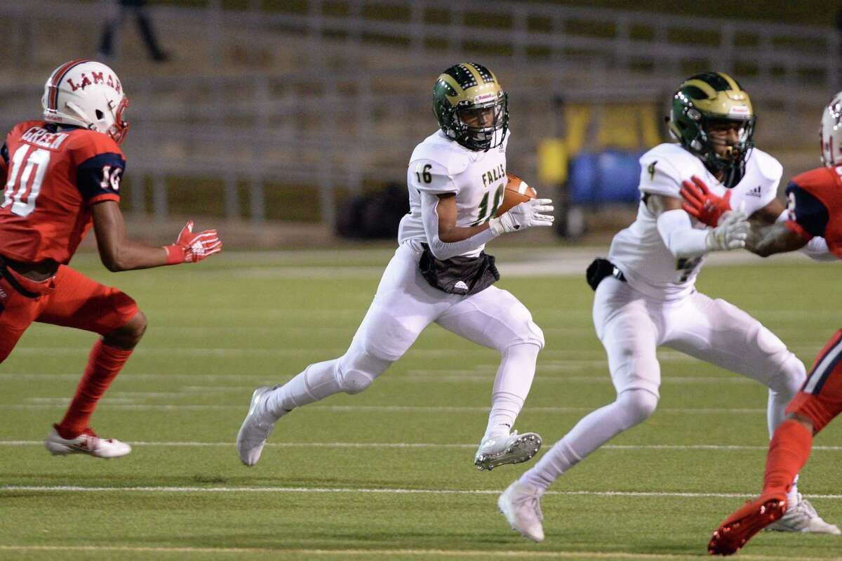 JP Martin (16) of Cy Falls carries the ball for a 21 yard gain during the first quarter of a Class 6A Division I Region III bi-district football playoff game between the Lamar Texans and the Cy Falls Eagles on Friday, November 15, 2019 at Delmar Stadium, Houston, TX.