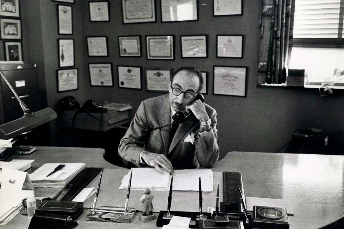 DeBakey at his desk at Baylor, (not previously published before this book).