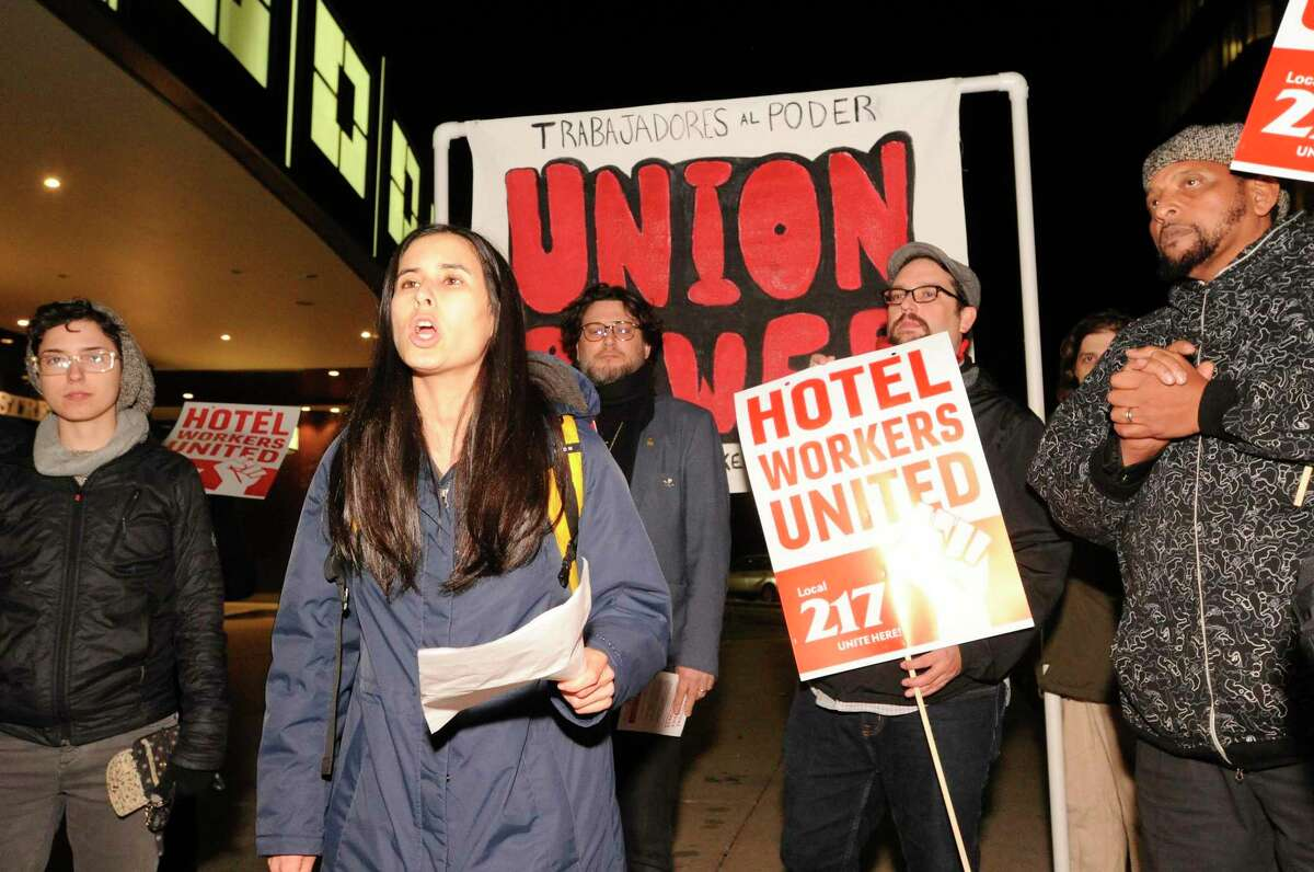 Talia Stender with the Yale Law School Worker and Immigrant Rights Advocacy Clinic speaks out as hotel workers from the Stamford Sheraton protest outside the hotel on Nov. 21, 2019 in Stamford, Connecticut. Employees filed a formal complaint with OSHA on Thursday about unsafe working conditions at the hotel. Some of the allegations against the hotel administration is that workers say they are exposed to concentrated chemicals and are not given the appropriate protection from them. Late last year, employees voted to form a union by joining UNITE HERE Local 217 and have been vocal against hotel leadership.