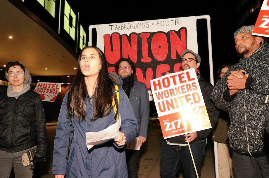 Talia Stender with the Yale Law School Worker and Immigrant Rights Advocacy Clinic speaks out as hotel workers from the Stamford Sheraton protest outside the hotel on Nov. 21, 2019 in Stamford. Photo: Matthew Brown / Hearst Connecticut Media / Stamford Advocate